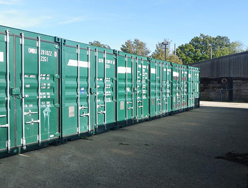 Large outdoor containers on concrete hardstanding